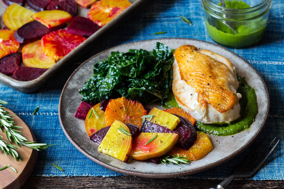 Chicken breasts and parsley-pecan pesto with roasted beets and oranges