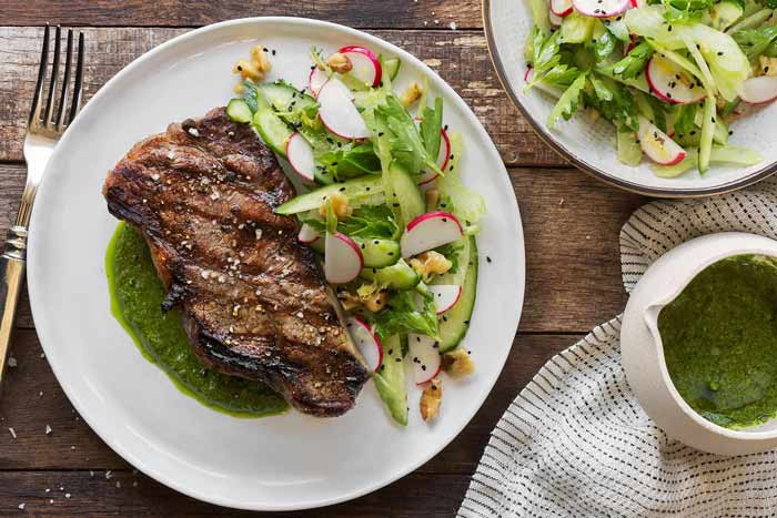Photo of Simple seared steak with arugula pesto and cucumber-radish salad, one of the delicious recipes featured in Sun Basket's Quick & Easy Meal Plan