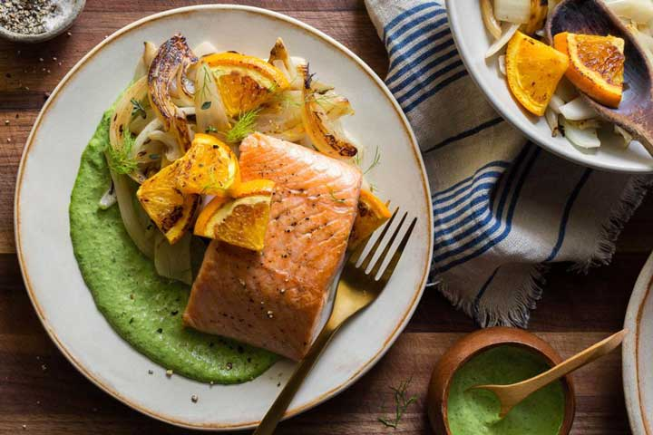 Salmon and braised fennel with charred orange and green goddess dressing