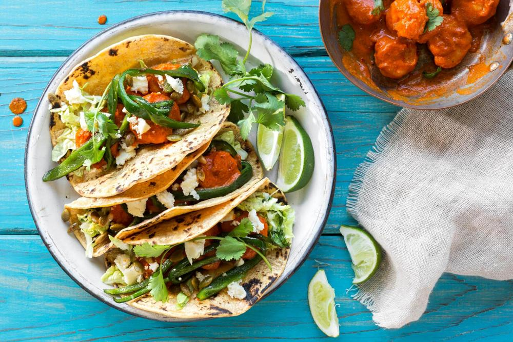 Shrimp tacos diablo with pickled cabbage and lime